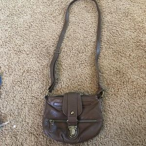 Tan strap body purse